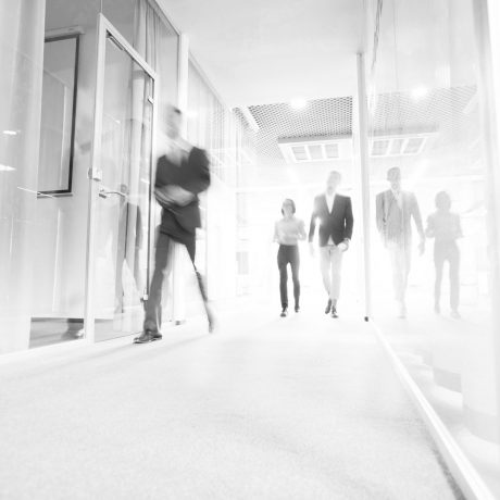 business-people-walking-in-office-corridor